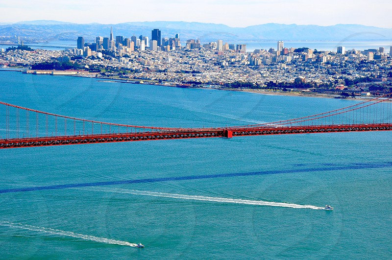 A piece of Golden Gate Bridge and San Francisco skyline from the top - California USA photo