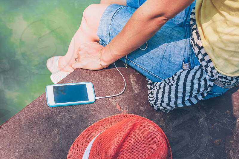 Young woman enjoying outdoors listening to the music photo