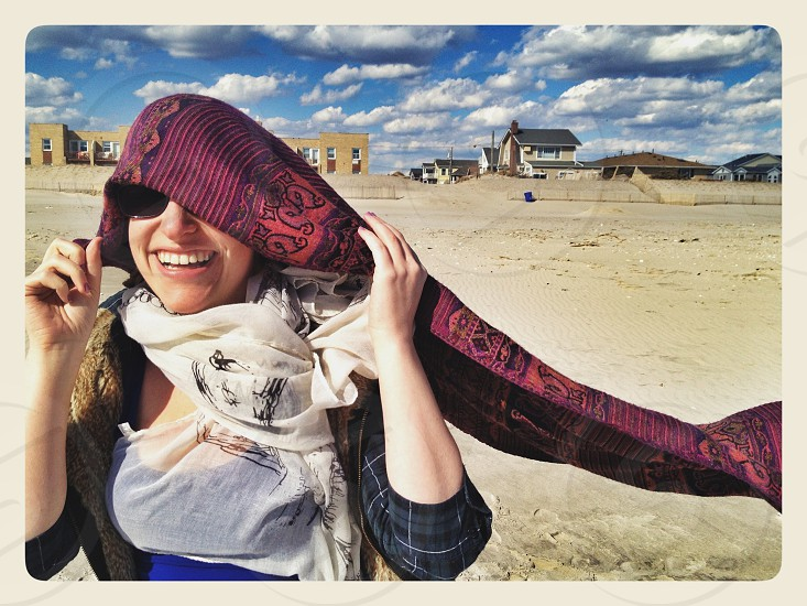 smiling woman black framed sunglasses photo