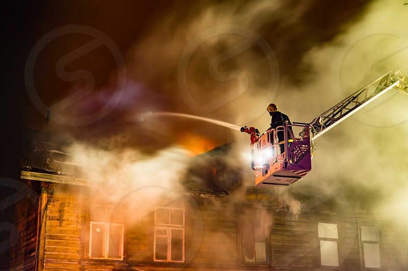 Fire; firefighter; fireman; brave; smoke; emergency; bravery photo