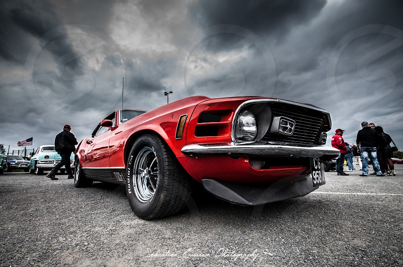 ford mustang under cloudy sky photo