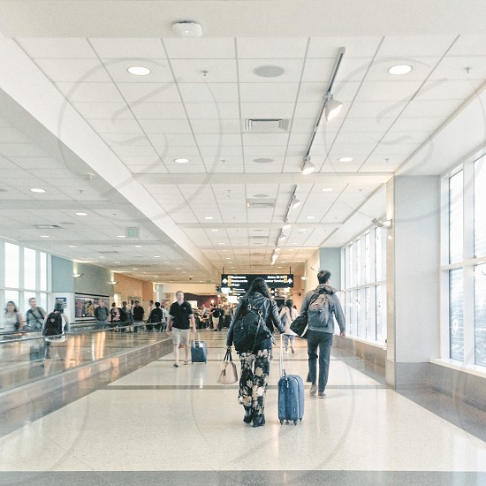 Airport people with suitcases  photo
