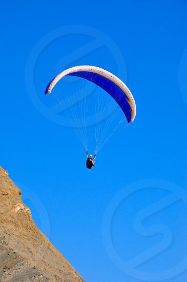 paraglider in the air over the mountains photo