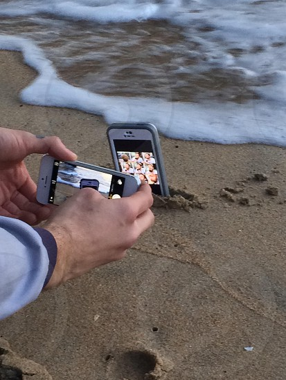 white smartphone on water photo