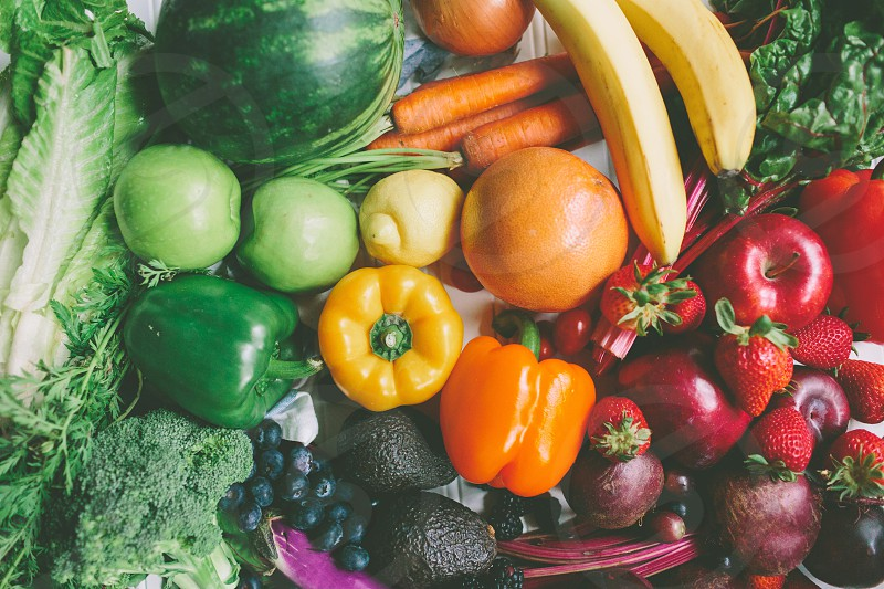 A top down view of a mix of colourful fruits and vegetables.  photo