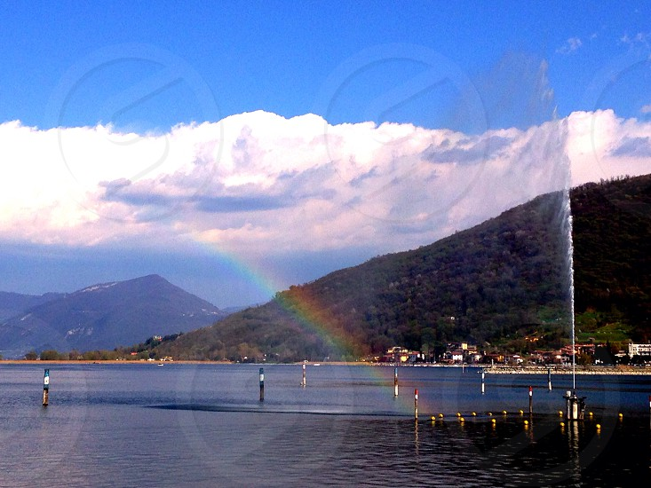 Lake landscape mountains water rainbow colours photo
