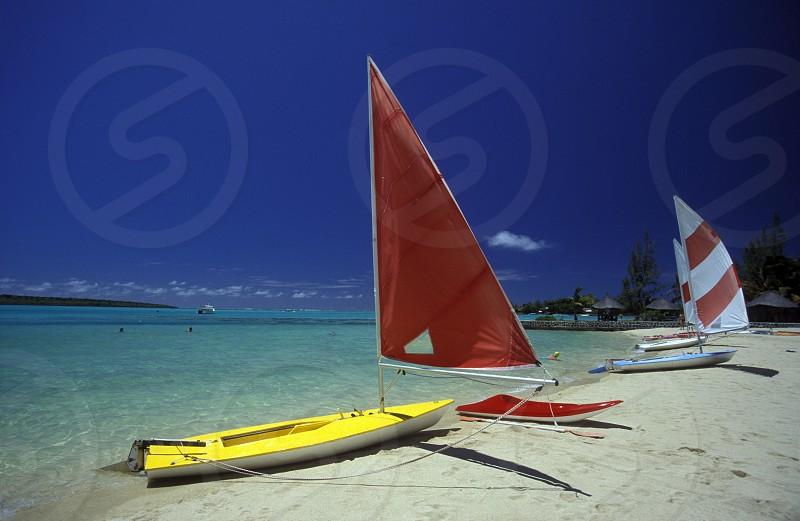 Ein Sandstrand an der ostkueste von Mauritius im Indischen Ozean.  photo