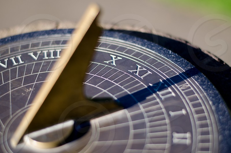 Sundial sunlight and shadow time clock photo