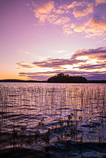Beautiful Sunset view of a silhouetted island from the shores of French Lake at Chippewa campground in Quetico Provincial Park Atikokan Ontario Canada photo