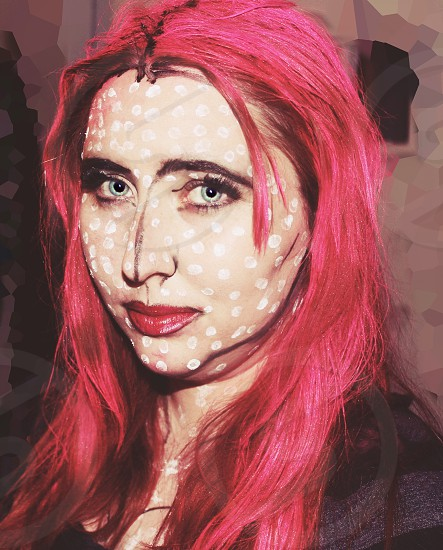 woman with pink straight hair with white dotted face makeup self portrait photo