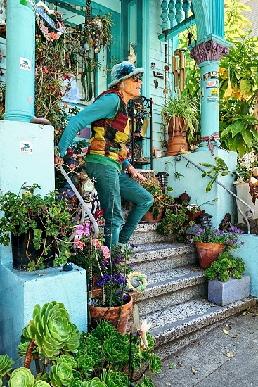 Add keywords separated by comma or semi-colons woman matching turquoise house photo