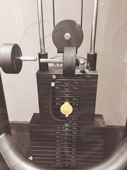 selective photo of black and stainless steel lbs exercise machine photo