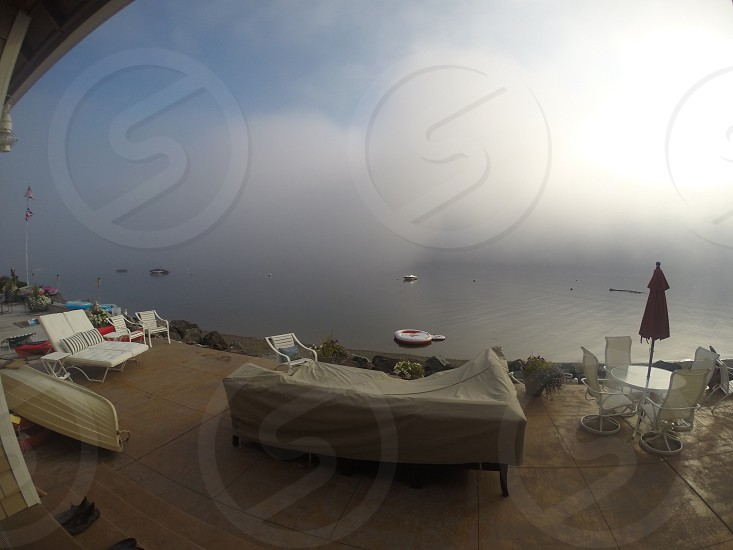 Fog over Puget Sound from the coast of Camano Island WA photo