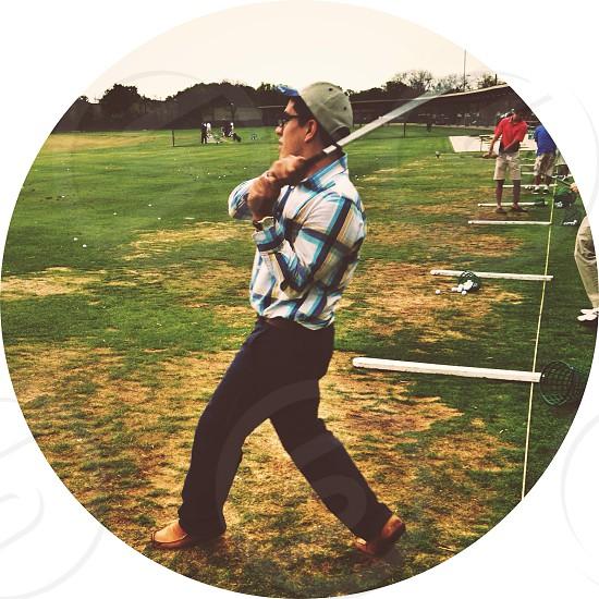 Golfing.  photo