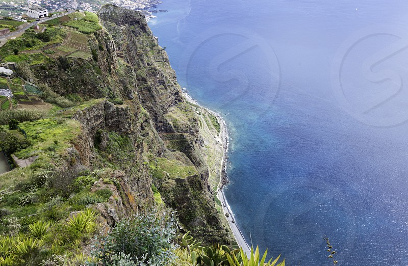 view from Miradouro do cabo Girao 550 meters above sea level to the west site near funchal on madeira island photo