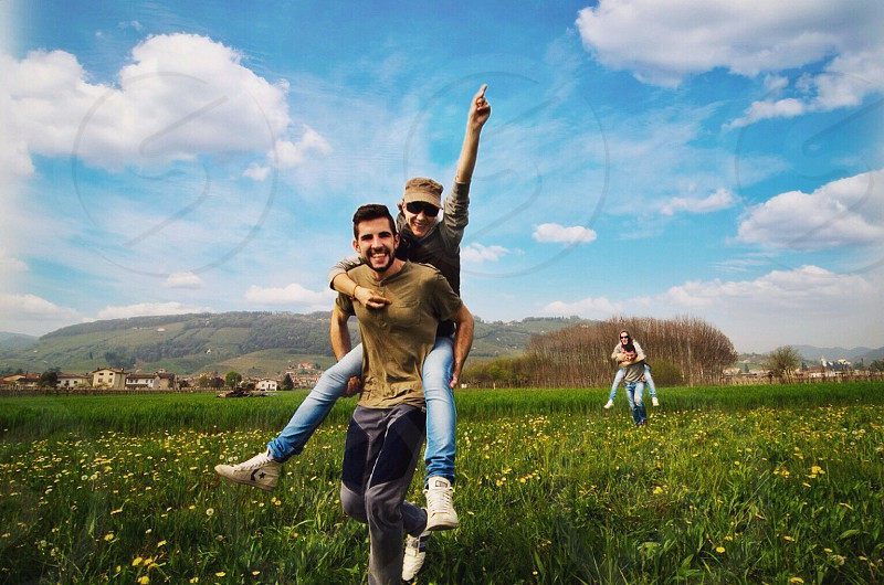 man and woman on field photo