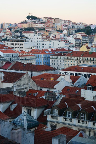 Scenic view of Lisbon Portugal's sun-kissed hills and charming old world architecture. photo