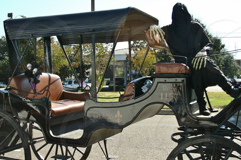 Grim reaper driving buggy photo