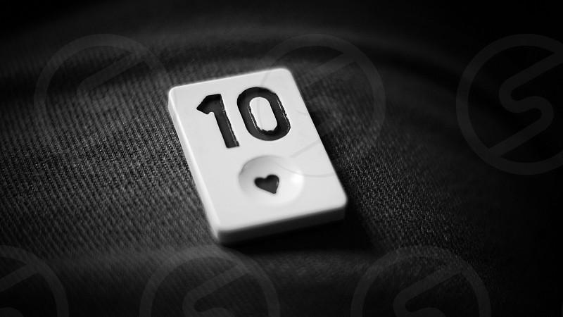 white number 10 tile on black textile photo