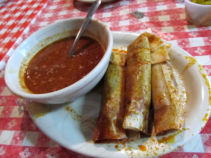 Tamales and bowl of chili photo