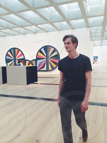 man in black shirt standing photo