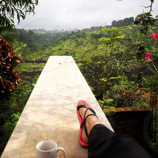 On top of the mountain enjoying a cup of coffee photo