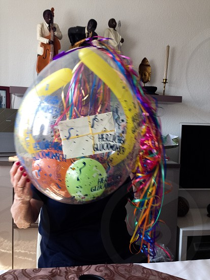 Holding the present Balloons and Presents inside the Balloon Ribbons  photo