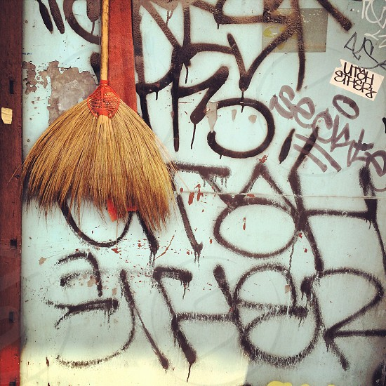 Broom on the graffiti wall  photo