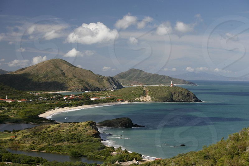 the Coast with the beach Playa Pedro Gonzalez in the town of Pedro Gonzalaz on the Isla Margarita in the caribbean sea of Venezuela. photo