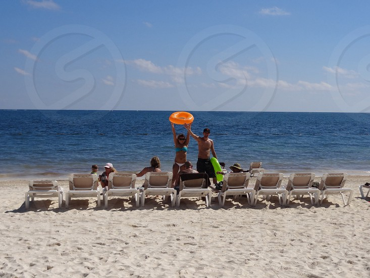 Beach chairs and young couple photo