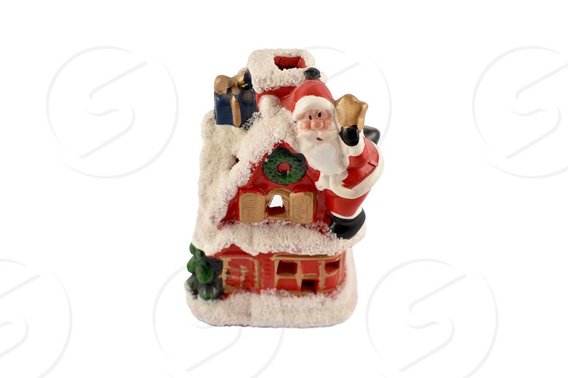 Santa Claus figurine. Santa decoration isolated on a white  background. Christmas candlelight lamp. Vintage santa candle holder photo