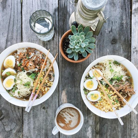 noodle soup in 2 bowls photo