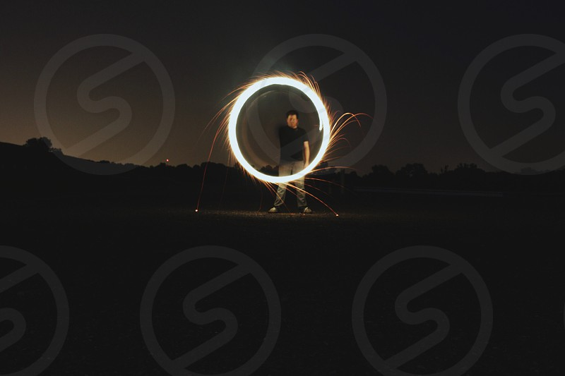 man holding circular light photo