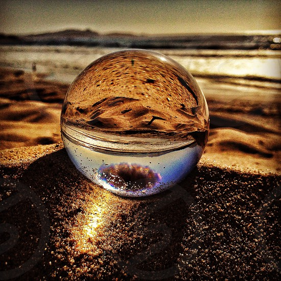 white glass reflective globe photo