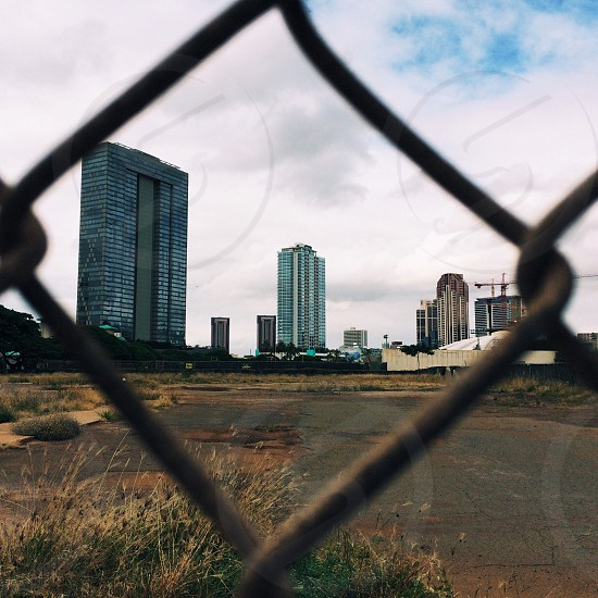 View of Honolulu through fence. photo