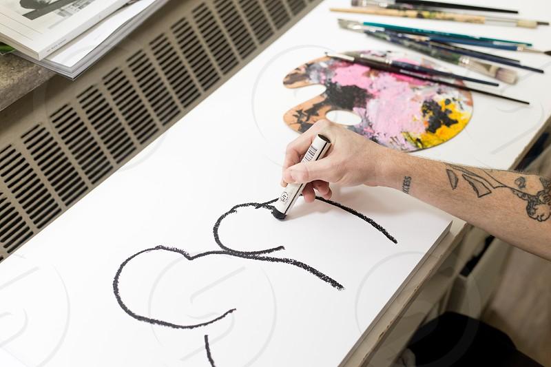 Job editorial - artist making multimedia art in the studio.  photo