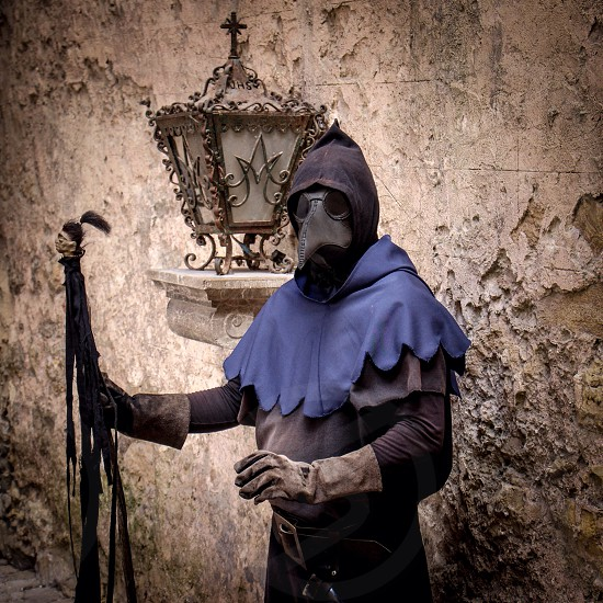 Plague doctor obidos portugal photo