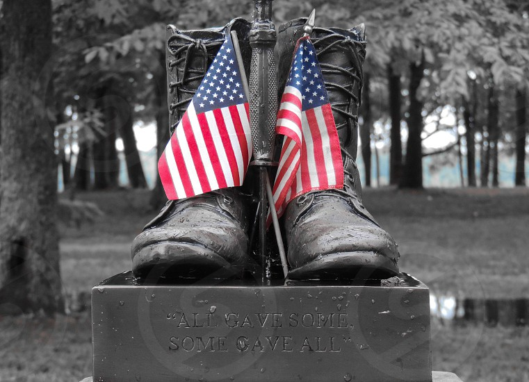Memorial Day statue decorated with American Flags photo