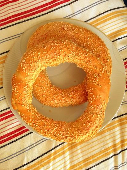 Orange Greek koulouri ring bread sesame seeds Turkish bagel photo