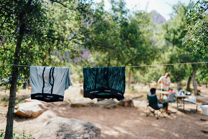 2 boxer briefs hanged on wire line for drying photo