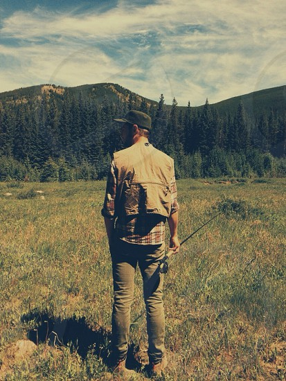 mens brown fishing vest photo