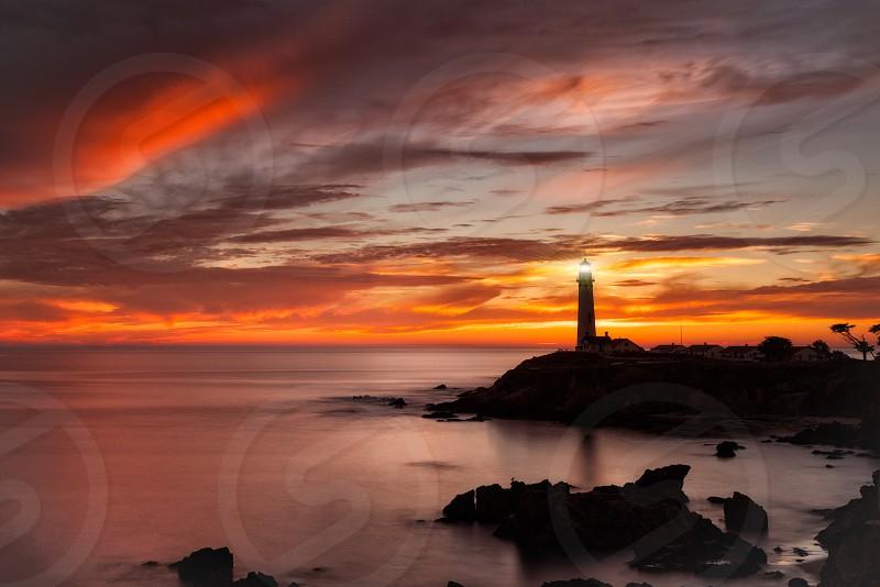 Lighthouse at sunset  photo