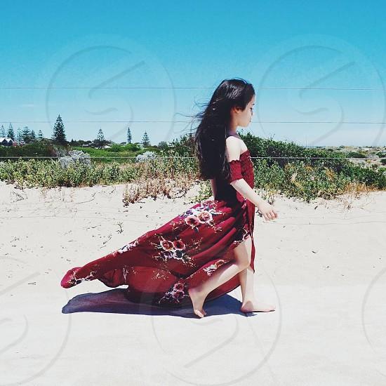 Girl walking beach model child brunette sand photo