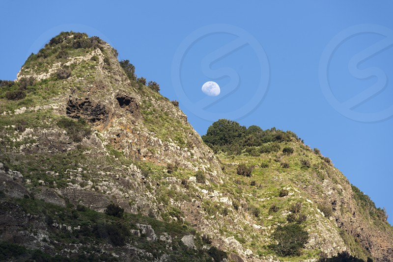 mounatain peakes on Madeira with blue sky and moon as background photo
