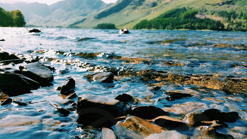 Pebbles close up on the lake  photo