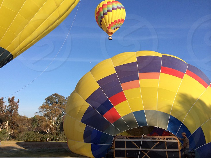 yellowblue and red hot air ballon photo