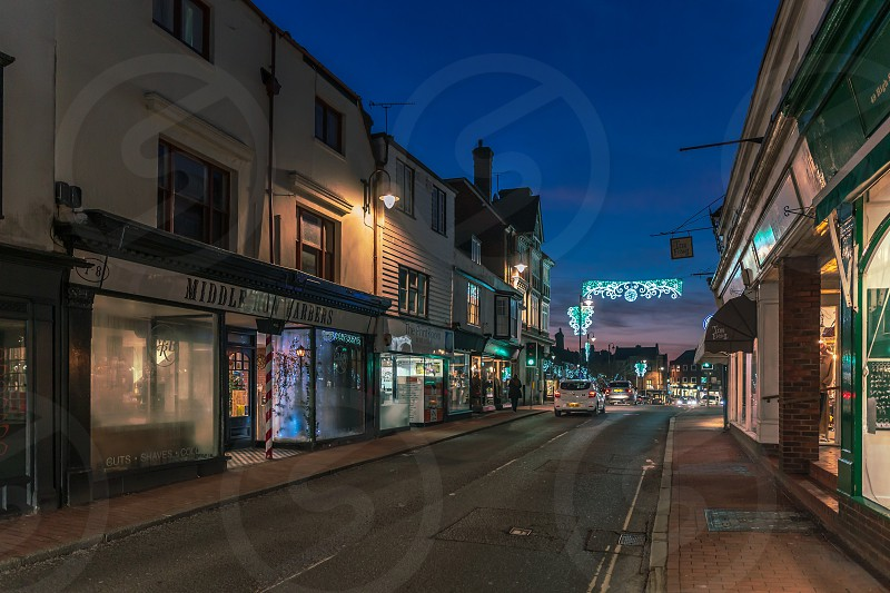 EAST GRINSTEAD WEST SUSSEX/UK - JANUARY 4  : View of the town centre at night in East Grinstead on January 4 2019. Three unidentified people photo
