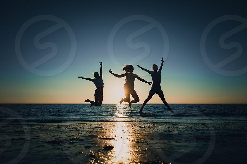 on the beach doing a jump photo