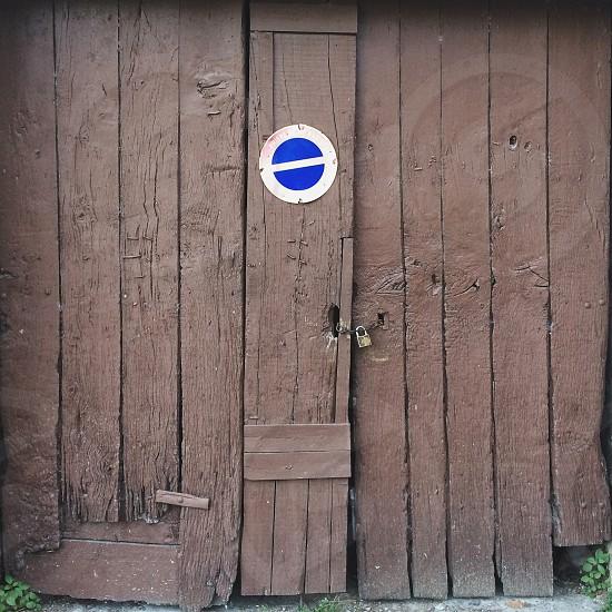 Blue white circle on wood door photo