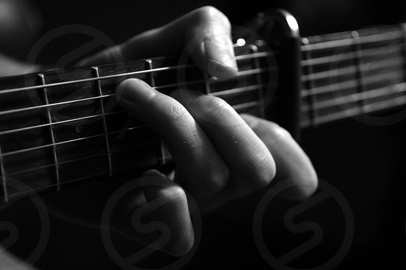 Guitar up close guitar playing finger on guitar strings photo